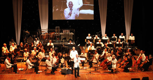 photograph by Hattie Miles ... 28.04.2019 ... Strictly Mantovani concert at Pavilion Bournemouth. Paul Barrett on percussion and conductor Timothy Henty with the Magic of Mantovani Orchestra.